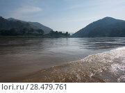 Scenic view of river with mountain range in background, River Mekong, Laos. Стоковое фото, фотограф Keith Levit / Ingram Publishing / Фотобанк Лори