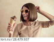 Купить «Ice cream woman singing in cone like in microphone happy, joyful and cheerful. Cute young female model eating ice cream cone», фото № 28479937, снято 18 января 2014 г. (c) Ingram Publishing / Фотобанк Лори