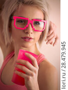 Купить «Hot blond girl with short hair wearing freak glasses holding plastic cup and looking at camera», фото № 28479945, снято 18 января 2014 г. (c) Ingram Publishing / Фотобанк Лори