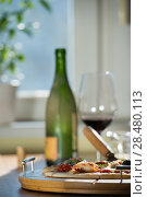 Купить «Supreme Pizza with glass of red wine and bottle at home», фото № 28480113, снято 3 мая 2014 г. (c) Ingram Publishing / Фотобанк Лори