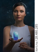 Купить «Futuristic woman holding the smart watch on a cosmic background», фото № 28480285, снято 17 мая 2014 г. (c) Ingram Publishing / Фотобанк Лори