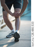 Купить «Unrecognizable fit young man stretching before exercise, sunrise early morning backlit. Shallow depth of field, focus on shoes», фото № 28480533, снято 22 июня 2014 г. (c) Ingram Publishing / Фотобанк Лори