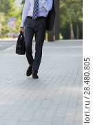 Купить «Unrecognizable businessman walking on the street near office building», фото № 28480805, снято 20 июля 2014 г. (c) Ingram Publishing / Фотобанк Лори