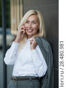 Купить «Successful businesswoman talking on cellphone outdoor. City business woman working.», фото № 28480981, снято 20 июля 2014 г. (c) Ingram Publishing / Фотобанк Лори
