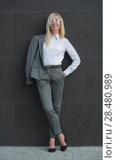 Portrait of elegantly dressed mature gorgeous blond business woman outdoor. Стоковое фото, фотограф Kirill Kedrinskiy / Ingram Publishing / Фотобанк Лори
