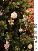 Купить «Christmas Tree on red background decorated with golden balls toys and bows», фото № 28481553, снято 3 ноября 2014 г. (c) Ingram Publishing / Фотобанк Лори