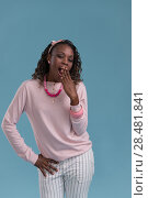 Купить «Tired and sleepy african woman yawning isolated over blue background», фото № 28481841, снято 19 ноября 2014 г. (c) Ingram Publishing / Фотобанк Лори