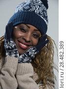 Купить «Portrait of african woman on gray background wearing woolen accessories», фото № 28482389, снято 20 ноября 2014 г. (c) Ingram Publishing / Фотобанк Лори