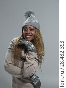 Купить «Fashion picture of beautiful smiling african woman wearing a woolen sweater and knitted hat with pompom», фото № 28482393, снято 20 ноября 2014 г. (c) Ingram Publishing / Фотобанк Лори