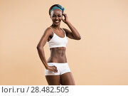 Купить «Portrait of young african athletic girl», фото № 28482505, снято 20 ноября 2014 г. (c) Ingram Publishing / Фотобанк Лори