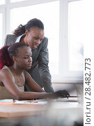 Купить «Young african business women in office working together on laptop», фото № 28482773, снято 1 декабря 2014 г. (c) Ingram Publishing / Фотобанк Лори