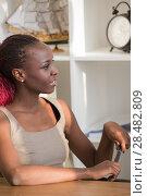 Купить «Authentic portrait of african business woman at real office environment», фото № 28482809, снято 1 декабря 2014 г. (c) Ingram Publishing / Фотобанк Лори