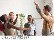 Купить «Business team celebrating a good job in the office», фото № 28482897, снято 1 декабря 2014 г. (c) Ingram Publishing / Фотобанк Лори