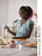 Young Woman Cooking at home. Healthy Food. Dessert Concept. Healthy Lifestyle. Cooking At Home. Prepare Food. Стоковое фото, фотограф Kirill Kedrinskiy / Ingram Publishing / Фотобанк Лори