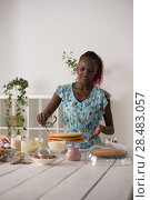 Купить «Young Woman Cooking at home. Healthy Food. Dessert Concept. Healthy Lifestyle. Cooking At Home. Prepare Food», фото № 28483057, снято 1 декабря 2014 г. (c) Ingram Publishing / Фотобанк Лори