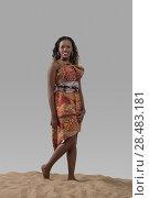 Купить «Attractive young African fashion model standing on sand on gray studio background», фото № 28483181, снято 1 декабря 2014 г. (c) Ingram Publishing / Фотобанк Лори