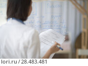 Купить «Medical doctor writing patient test results on transparent board to diagnose», фото № 28483481, снято 6 июня 2015 г. (c) Ingram Publishing / Фотобанк Лори
