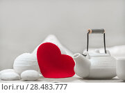 Купить «Valentine's day surprice for couple. Romantic tea set with red heart», фото № 28483777, снято 19 декабря 2012 г. (c) Ingram Publishing / Фотобанк Лори