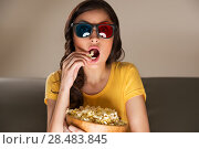 Купить «Young woman with popcorn and 3d glasses watching movie at home», фото № 28483845, снято 19 декабря 2012 г. (c) Ingram Publishing / Фотобанк Лори