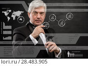 Купить «Businessman standing and working wth touch screen technology», фото № 28483905, снято 28 января 2013 г. (c) Ingram Publishing / Фотобанк Лори