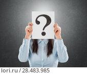 Young woman holding interrogation symbol in front of her face. Стоковое фото, фотограф Kirill Kedrinskiy / Ingram Publishing / Фотобанк Лори