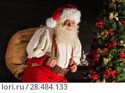 Купить «Real Santa Claus carrying big bag full of gifts, at home near Christmas Tree», фото № 28484133, снято 31 января 2013 г. (c) Ingram Publishing / Фотобанк Лори