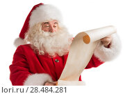 Купить «Portrait of happy Santa Claus reading Christmas letter isolated on white background», фото № 28484281, снято 17 января 2013 г. (c) Ingram Publishing / Фотобанк Лори