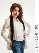 Купить «Hot woman with hands on hips on white background», фото № 28484305, снято 22 сентября 2013 г. (c) Ingram Publishing / Фотобанк Лори