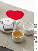 Купить «Valentine's day surprice for couple. Romantic tea set with red heart», фото № 28484485, снято 19 декабря 2012 г. (c) Ingram Publishing / Фотобанк Лори