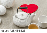 Купить «Valentine's day surprice for couple. Romantic tea set with red heart», фото № 28484525, снято 19 декабря 2012 г. (c) Ingram Publishing / Фотобанк Лори