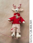 Купить «Handmade vintage Christmas deer hanging on a ribbon on grunge old natural colored paper background», фото № 28484581, снято 3 ноября 2012 г. (c) Ingram Publishing / Фотобанк Лори
