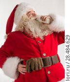 Купить «Portrait of Santa Claus Drinking milk from glass bottle. Greeting card background», фото № 28484629, снято 17 января 2013 г. (c) Ingram Publishing / Фотобанк Лори