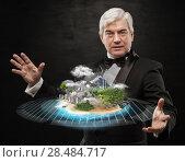 Better world project concept. Mature business man presenting his better world project. Стоковое фото, фотограф Kirill Kedrinskiy / Ingram Publishing / Фотобанк Лори