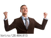 Купить «Business man throwing fists in air and smiling while celebrating success isolated on white background», фото № 28484813, снято 2 февраля 2013 г. (c) Ingram Publishing / Фотобанк Лори