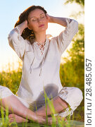 Купить «Stretching woman in outdoor exercise smiling happy doing yoga stretches. Beautiful happy smiling sport fitness model outside on summer / spring day», фото № 28485057, снято 22 июня 2013 г. (c) Ingram Publishing / Фотобанк Лори