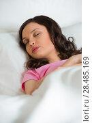 Купить «Young beautiful woman sleeping on the bed and dreams», фото № 28485169, снято 18 декабря 2012 г. (c) Ingram Publishing / Фотобанк Лори