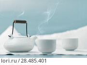 Купить «Teapot and cups on table at comfortable relaxation lounge», фото № 28485401, снято 19 декабря 2012 г. (c) Ingram Publishing / Фотобанк Лори