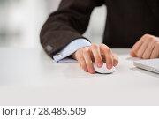 Купить «Closeup of torso of confident business man wearing elegant suit working with his laptop at office», фото № 28485509, снято 23 декабря 2012 г. (c) Ingram Publishing / Фотобанк Лори