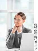 Portrait of smiling caucasian female executive working on laptop and making pause. Стоковое фото, фотограф Kirill Kedrinskiy / Ingram Publishing / Фотобанк Лори