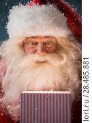 Купить «Happy Santa Claus opening his Christmas gift at North Pole», фото № 28485881, снято 25 сентября 2013 г. (c) Ingram Publishing / Фотобанк Лори