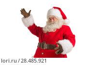 Купить «Santa Claus gesturing his hand isolated over white background. Presenting something», фото № 28485921, снято 17 января 2013 г. (c) Ingram Publishing / Фотобанк Лори