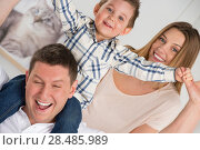 Купить «Beautiful happy family having fun at home», фото № 28485989, снято 31 марта 2013 г. (c) Ingram Publishing / Фотобанк Лори