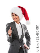 Купить «Christmas woman showing thumbs up. Young smiling woman with red santa hat. Image of beautiful young Caucasian model isolated on perfect white background.», фото № 28486081, снято 2 февраля 2013 г. (c) Ingram Publishing / Фотобанк Лори