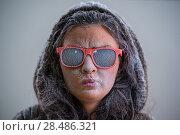Купить «Pretty woman wearing winter outfit and sunglasses. Bemused expression on her face», фото № 28486321, снято 23 сентября 2013 г. (c) Ingram Publishing / Фотобанк Лори