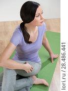 Купить «Portrait of healthy young lady practicing yoga exercise - Spine twisting pose», фото № 28486441, снято 27 ноября 2012 г. (c) Ingram Publishing / Фотобанк Лори