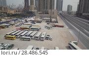Купить «Public Transport Parking in Downtown Dubai stock footage video», видеоролик № 28486545, снято 7 апреля 2018 г. (c) Юлия Машкова / Фотобанк Лори
