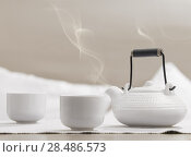 Купить «Teapot and cups on table at comfortable relaxation lounge», фото № 28486573, снято 19 декабря 2012 г. (c) Ingram Publishing / Фотобанк Лори