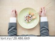 Купить «Aerial closeup of a sushi platter», фото № 28486669, снято 11 января 2012 г. (c) Ingram Publishing / Фотобанк Лори