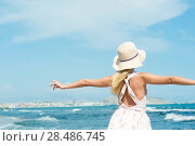 Купить «A woman enjoys the summer breeze at a seaside town», фото № 28486745, снято 22 сентября 2011 г. (c) Ingram Publishing / Фотобанк Лори