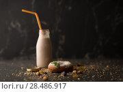 Купить «Sugar powder Donut with mint leaf and milk bottle on dark stone background», фото № 28486917, снято 12 февраля 2015 г. (c) Ingram Publishing / Фотобанк Лори